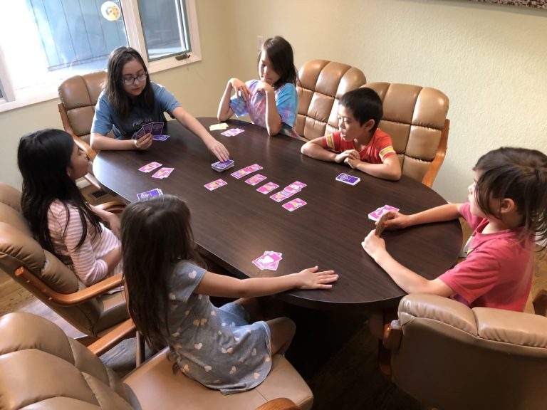 family-stack-the-scoops-playing-at-table